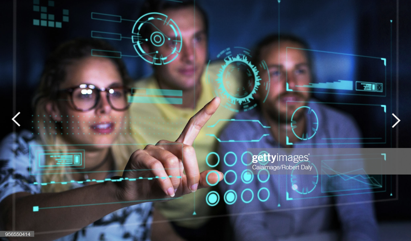 stock photo of people interacting with a digital screen