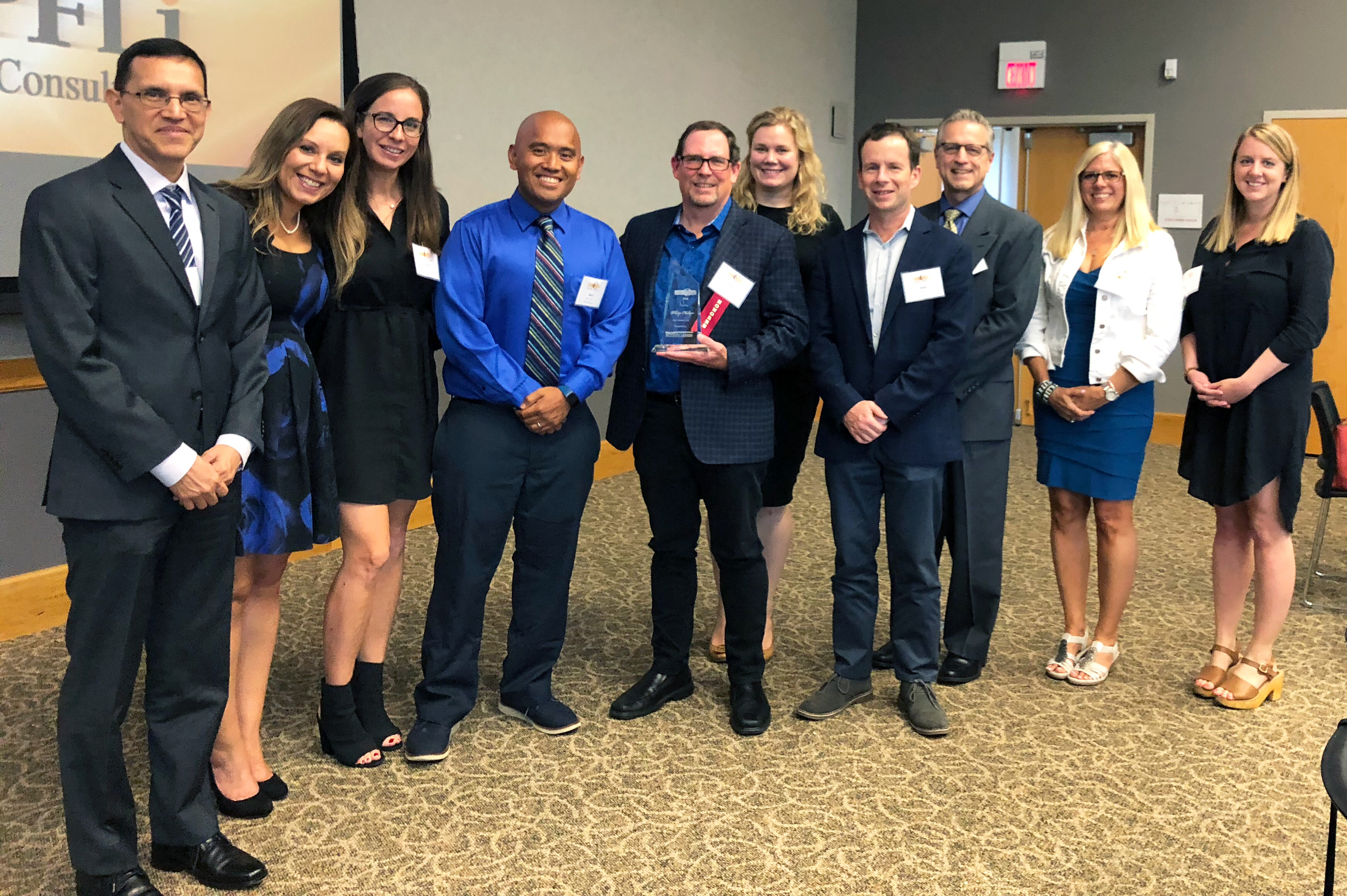 Phil Hollyer, co-founder and CEO of Bounteous, sports his C-Suite of the Year award surrounded by colleagues at the awards reception on Thursday, July 26 in Naperville, IL.