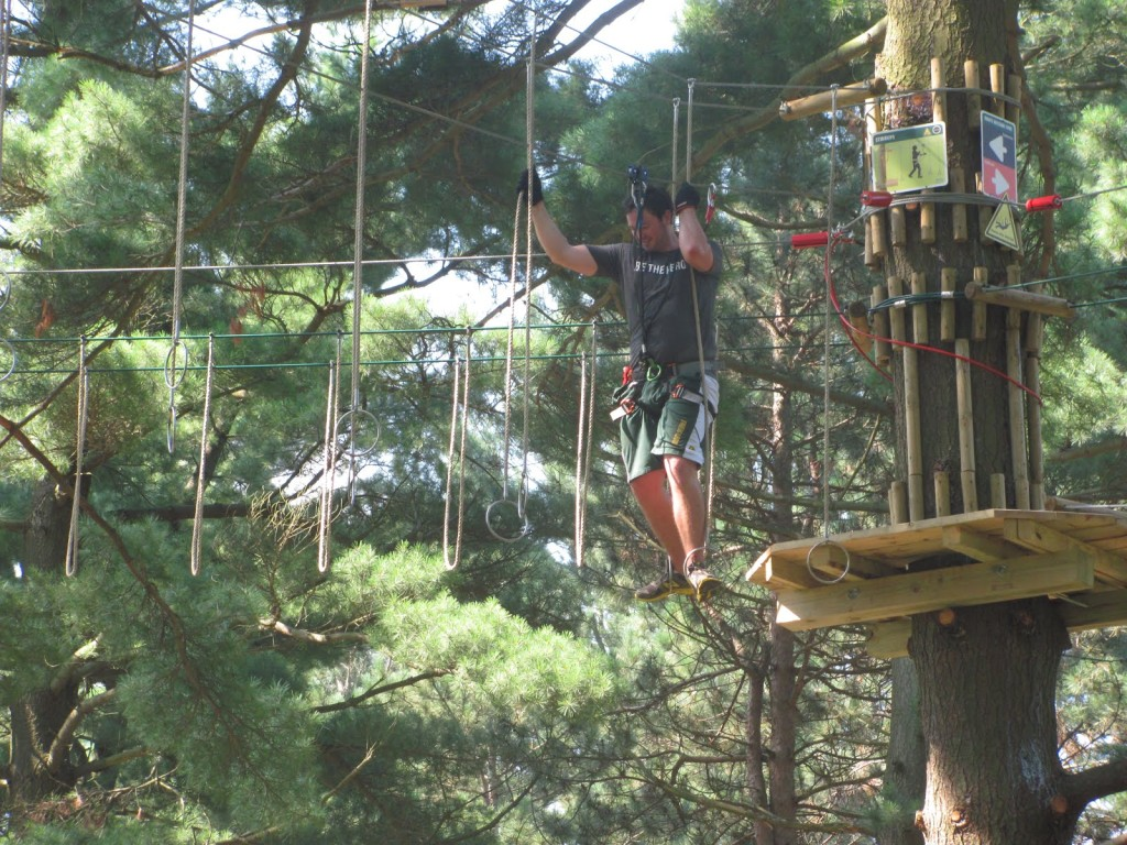 Stephen Kapusta completes a hoop-ring obstacle on the Go Ape! zipline and ropes challenge course