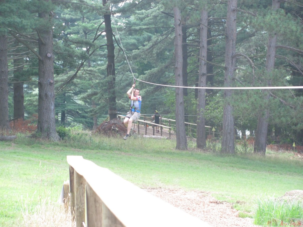 Jim Gianoglio flys down one of the giant ziplines between course obstacles