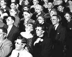 theater audience wearing 3D glasses