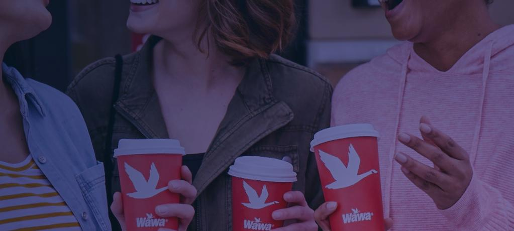 A crowd holding Wawa branded cups